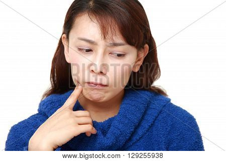 Asian woman worries about something on white background