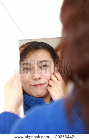 Asian woman with good condition skin on white background
