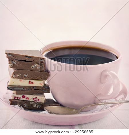Pile of chocolate and coffee in a pink cup