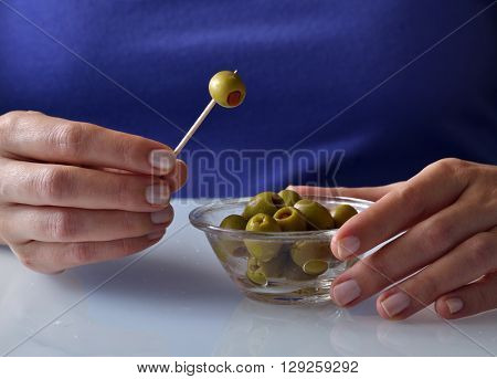 Picking olives with toothpick