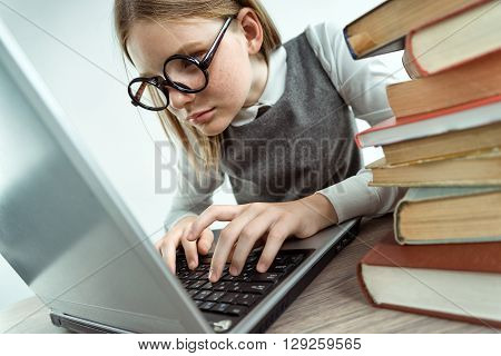 Young attractive Student using laptop. Photo of teen absorbedly looking on laptop creative concept with Back to school theme