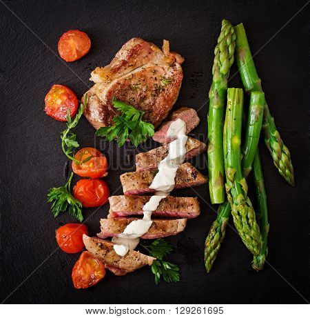 Juicy Steak Medium Rare Beef With Spices And Tomatoes, Asparagus. Top View