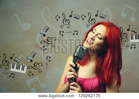 Beautiful woman singing into microphone against musical background with notes and clefs