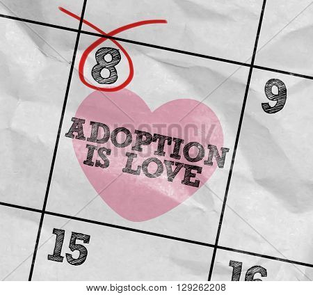 Concept image of a Calendar with the text: Adoption is Love