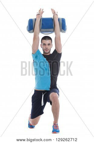 Fitness trainer doing a demonstration of core bag exercise. Image isolated on white background.