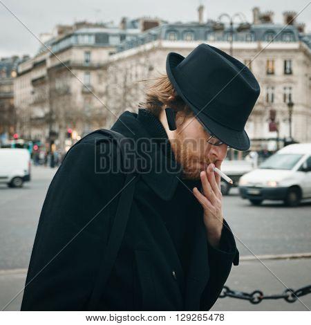 Bearded Man Wearing Hat Smoking