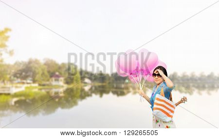 Asian Women Wearing Sunglasses With Ukulele In Summer Bag Carried On The Shoulder Taking Heart Shape