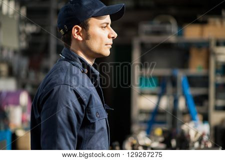 Portrait of a worker in his factory