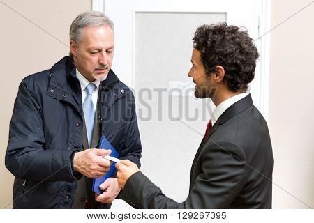 Businessman introducing to a colleague