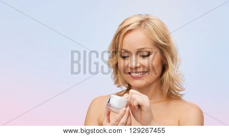 beauty, people, skincare and cosmetics concept - happy woman with cream jar over rose quartz and serenity gradient background