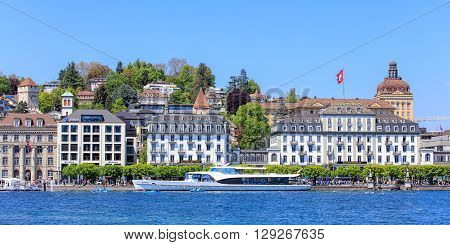 Lucerne, Switzerland - 8 May, 2016: view on the Schweizerhofquai quay across Lake Lucerne with the