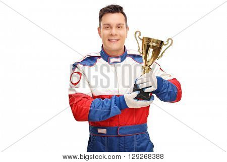Young car racing champion holding a gold trophy and looking at the camera isolated on white background