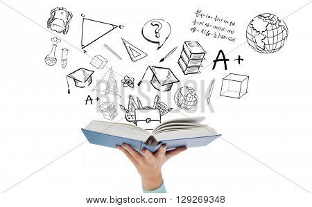 education, school and learning concept - close up of woman hand holding open blue book with doodles