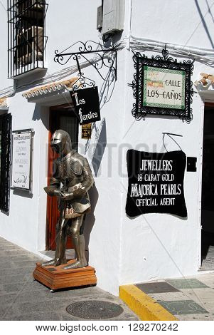 MIJAS, SPAIN - JUNE 14, 2008 - Suit of armour outside a shop on the corner of Calle Los Canos Mijas Malaga Province Andalucia Spain Western Europe, June 14, 2008.