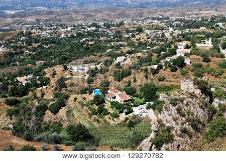 Elevated view of villas with a swimming pools and surrounding mountain landscape Mijas Malaga Province Andalucia Spain Western Europe. ** Note: Soft Focus at 100%, best at smaller sizes