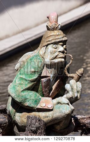 The water goblin statue guarding Velkoprerovsky Mill, the water mill on Certovka or Devil's stream on Kampa island, Prague, Czech Republic
