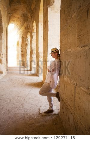 Woman in Tunisia El Jem roman apmphitheatre. Largest colosseum in in North Africa. El JemTunisia. UNESCO