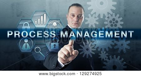 Entrepreneur pushing PROCESS MANAGEMENT on a virtual touch screen display. Business concept for planning activity performance monitoring and application of knowledge and tools to improve a process.