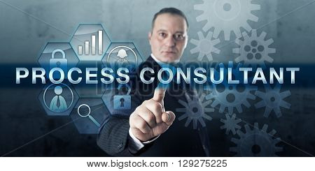Qualified professional is pushing PROCESS CONSULTANT on a visual touch screen display. Business concept for a facilitator helping with strategic planning tasks and conflict management.