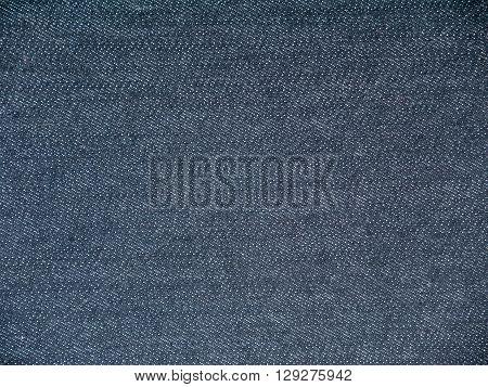 Dark rinse wash navy denim fabric background