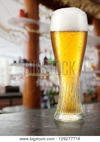 Glass of light beer in a pub.