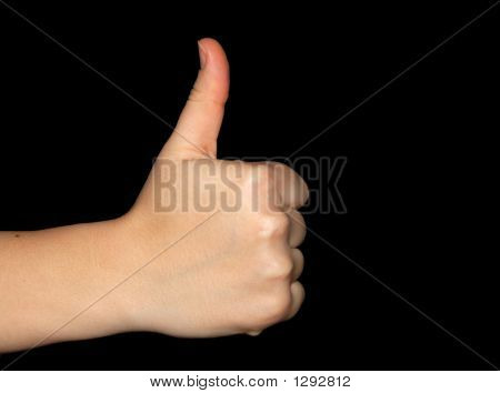 Thumbs Up Over A Black Background