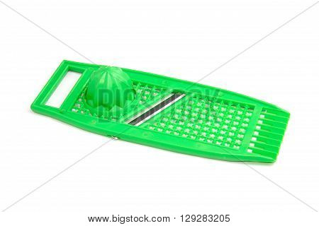 Plastic juicer in grater on white background