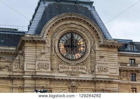 Paris, France - May 11 2013: This is a clock on the building of the former railway station of Paris-Orleans and now Orsi Museum May 11, 2013 in Paris, France.