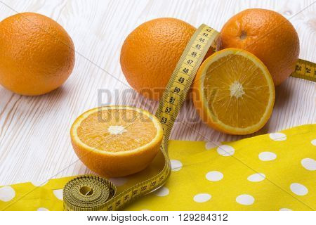 Oranges with measurement  on the wooden table