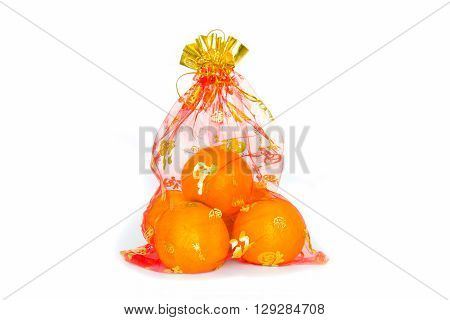 auspicious orange is in red bag isolated on white background