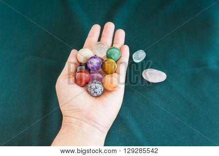 Colourful round stones in hand quartz gem