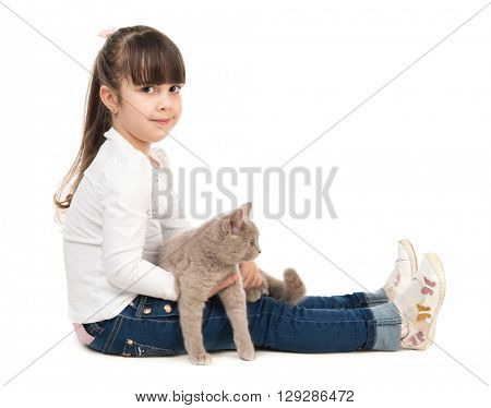 cute little girl sitting on the floor with cat in hands isolated on white background
