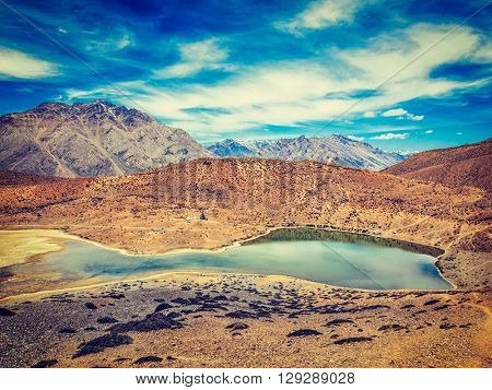 Vintage retro effect filtered hipster style image of Dhankar lake in Himalayas. Dhankar, Spiti valley, Himachal Pradesh, India