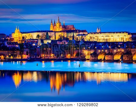 Travel Prague Europe tourism concept background - view of Charles Bridge and Prague Castle in twilight. Prague, Czech Republic