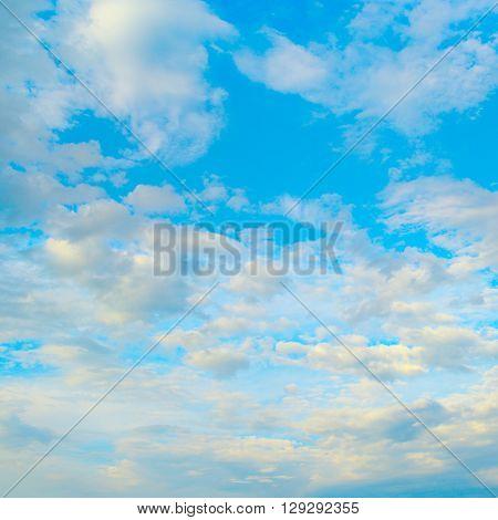 Light clouds in blue sky. Heavenly landscape.