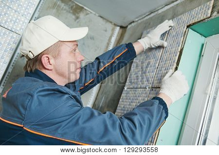 tiler at indoor wall tiling renovation
