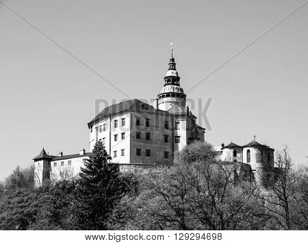 Frydlant v Cechach - Gothic castle and Renaissance chateau with high tower in northern Bohemia, Czech Republic. Black and white image.