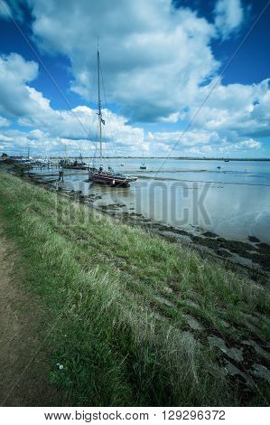 An Old Boat at Heybridge Basin Essex near to the shore as the tide is going out