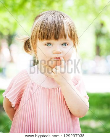 Cute beautiful girl on the nature background