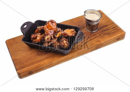 Chicken Buffalo Wings with sauce on wooden board isolated