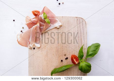 Black forest ham on wooden cutting board