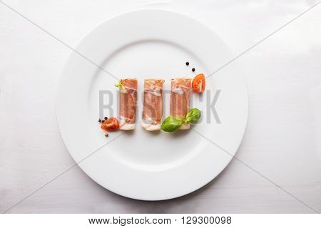 Black forest ham on white plate