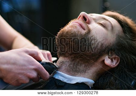 Man's Face At The Barber's