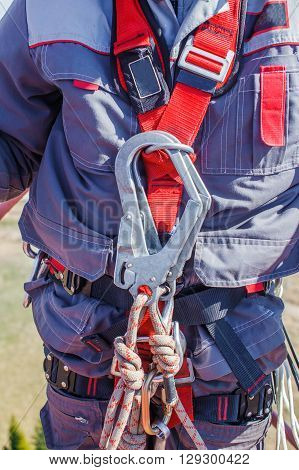 tower technician. working equipment and work wear for high-altitude works on a telecommunication tower. fall arrest system