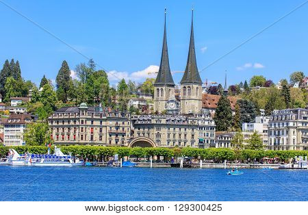 Lucerne, Switzerland - 8 May, 2016: view on Kurplatz square from Bahnhofquai with the towers of the Church of St. Leodegar in the background. The Church of St. Leodegar  is the most important church and a landmark of the city.