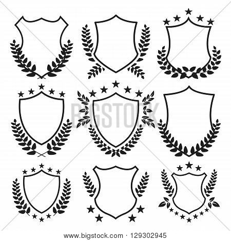 Medieval shields with stars and laurel wreaths set. Awards, trophy, vintage insignia shields collection. Premium quality. Black color. Vector illustration isolated on white background