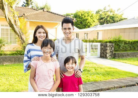 Beautiful smiling family portrait outside their house