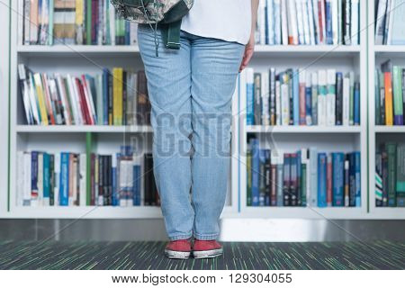 smart looking famale student  in library reading book