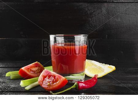 Bloody Mary with celery lemon hot pepper on a dark background