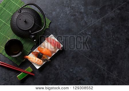 Set of sushi and green tea on stone table. Top view with copy space